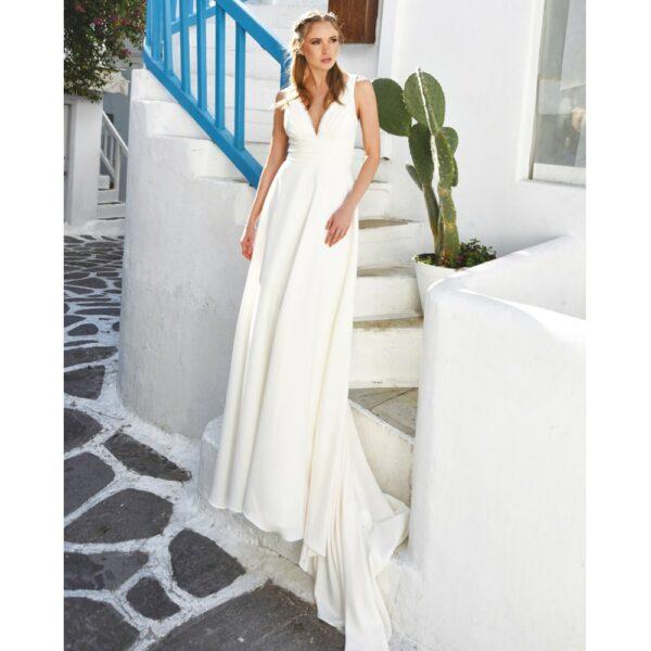 Robe de mariée longue Marina. Robe bohème chic disponible dans notre boutique mariage à Paris 11ème. Prendre un RDV privé