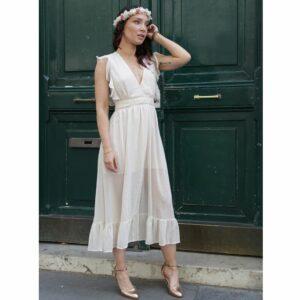 Robe mi-longue rose nude. Robe chic pour mariage et évènement à moins de 100€. Acheter en ligne ou en boutique à Paris