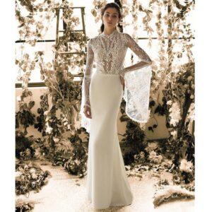 Robe de mariée longue Pia Metropolitan collection 2020. Robe boho chic tout en dentelle dans notre boutique mariage à Paris 11ème. Prendre un RDV