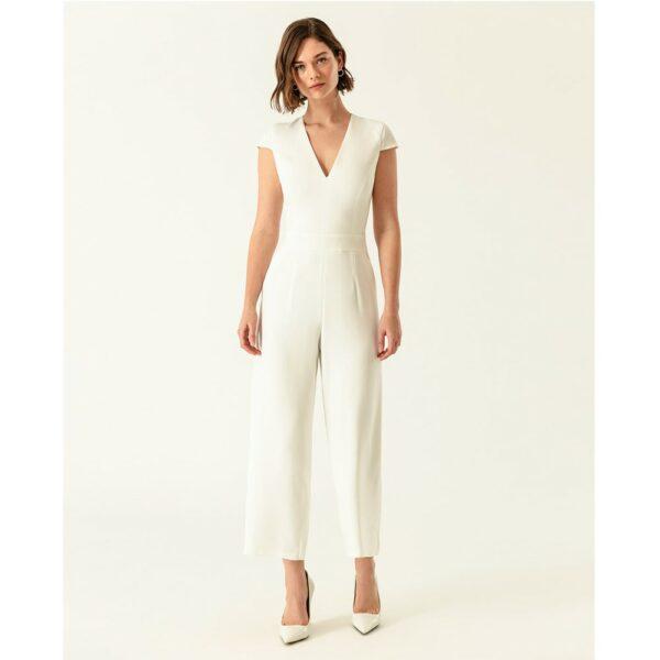 Combinaison pantalon blanc ivoire à petites manches. Tenue mariée blanche stylée. combi mariage petit prix. Acheter en ligne et boutique Paris