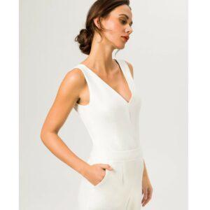 Combinaison pantalon blanc ivoire sans manches. Tenue mariée blanche stylée. combi mariage petit prix. Acheter en ligne et boutique Paris