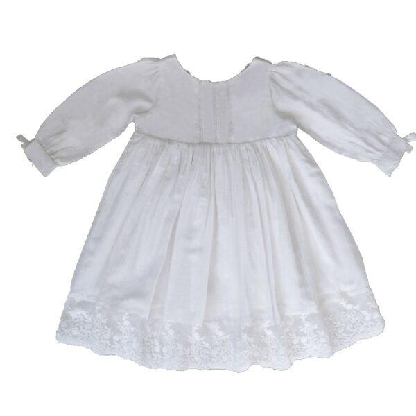 Robe fille Apolline Les Petits Inclassables baptême cérémonie et cortège pour petite fille. Robe blanche manches longues rétro vintage. Dispo boutique Paris