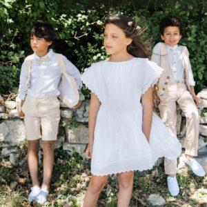 Robe fille Sophie Les Petits Inclassables baptême cérémonie et cortège pour petite fille. Robe blanche manches courtes rétro vintage. Dispo boutique Paris