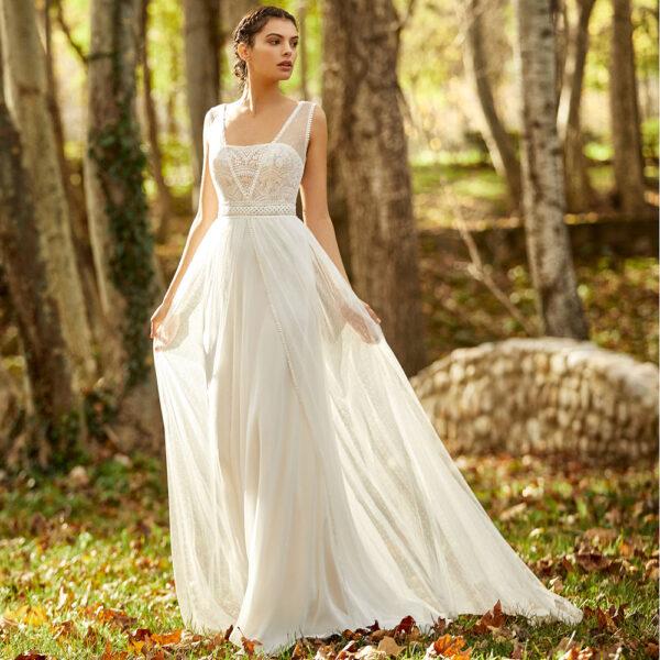 Robe de mariée bohème Oceania collection Alma 2021. robe de mariée dentelle et dos nu fluide. Essayer boutique mariage paris